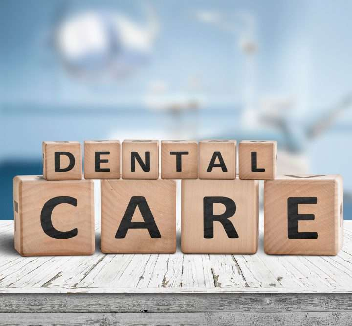 Dental,Care,Sign,On,A,Table,At,A,Dentist,With